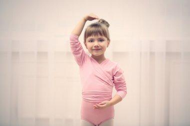 cute girl in pink leotard