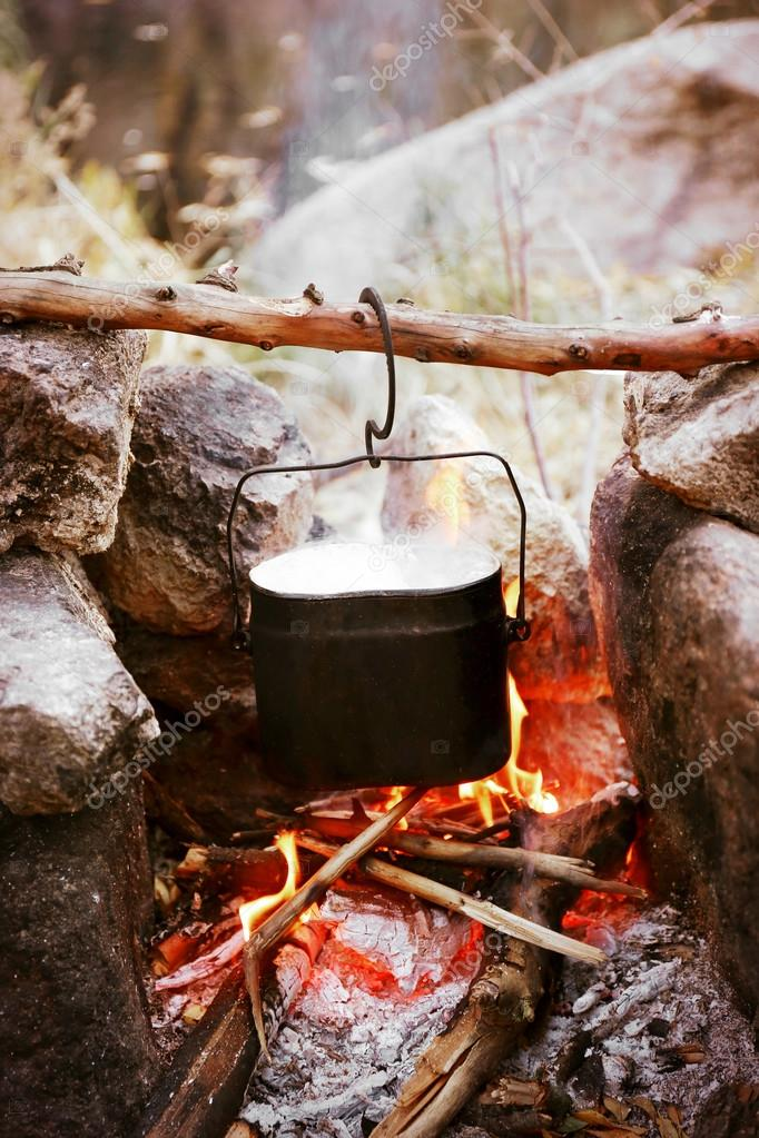 Kettle hanging above fire