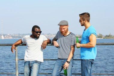 men talking on riverside