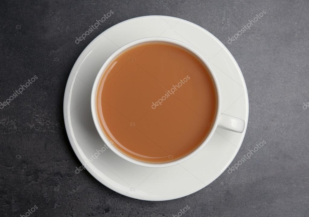 Porcelain cup of tea with milk — Stock Photo © belchonock