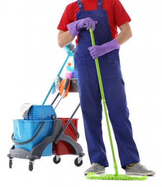 Young janitor with cleaner cart