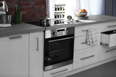 Modern kitchen table with electric stove