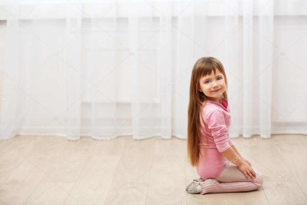 5df27670f5a0 cute girl in pink leotard — Stock Photo © belchonock  105078440