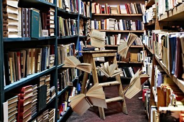 Flying books on library bookshelves