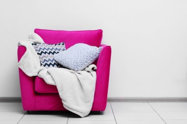 Pink armchair with blanket