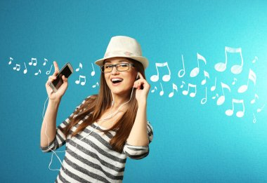Young woman listens to music