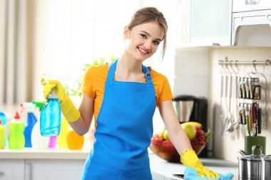 Woman washes oven