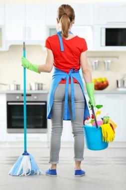Woman with floor mop