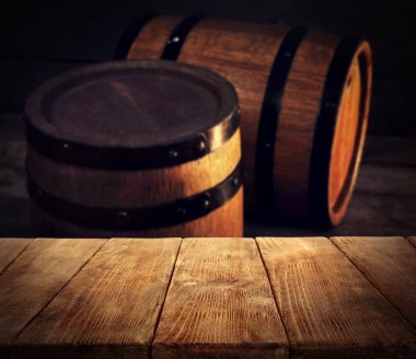 Barrels of wine and wooden desk