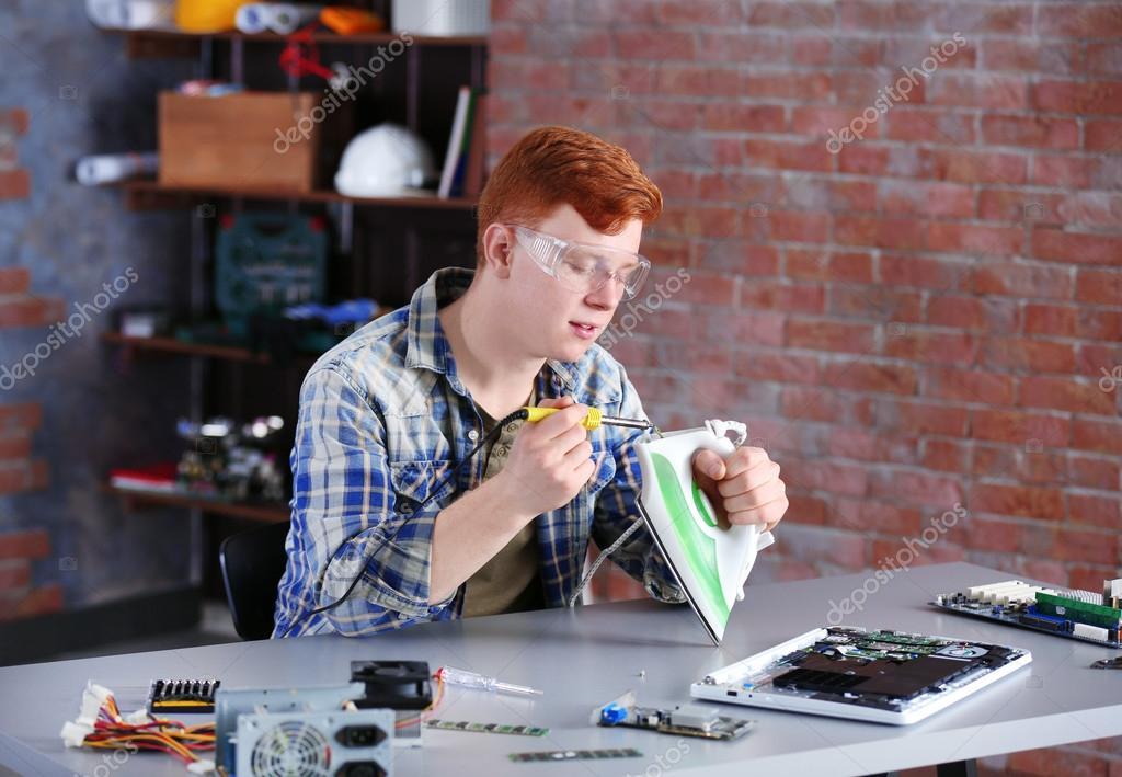 man working in repair center