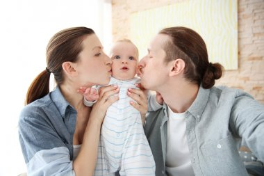 couple taking a selfie with baby