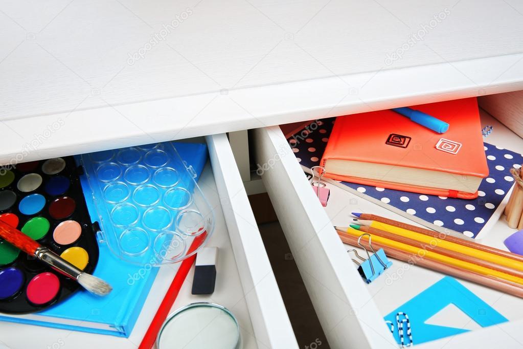 Stationery in open desk drawer — Stock Photo © belchonock