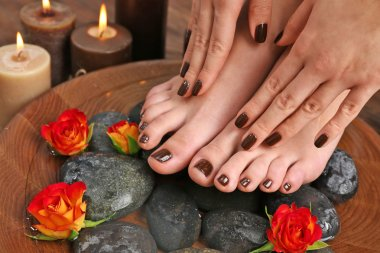 Manicured female feet