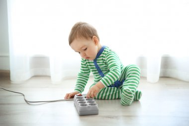 baby playing with electric power bar