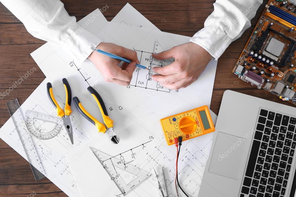 Male hands drawing electrical blueprint — Stock Photo © belchonock ...
