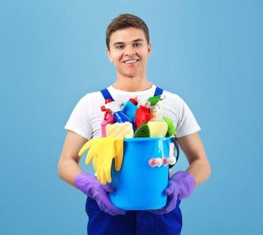 Man holding plastic bucket