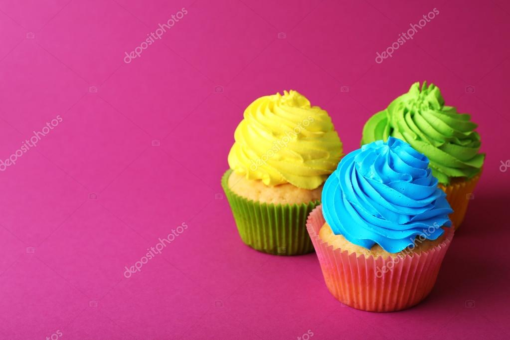 Colorful Birthday Cupcakes On Pink Background Photo By Belchonock