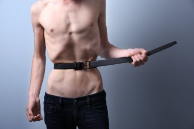 Skinny young man with anorexia