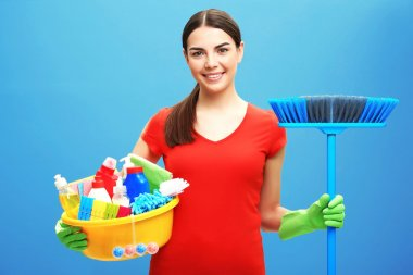 Female cleaner on background