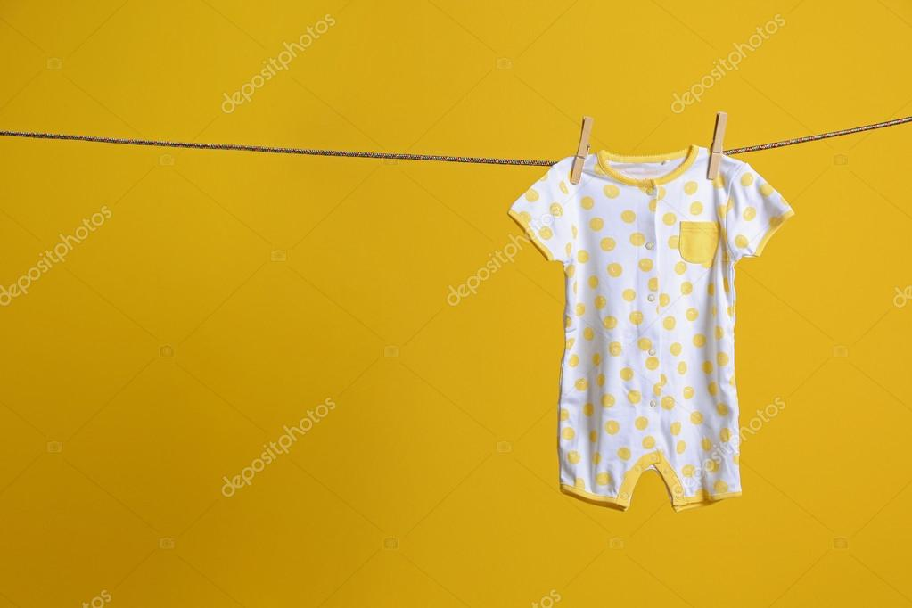 454741fb0 Baby clothes hanging on rope — Stock Photo © belchonock  114906412