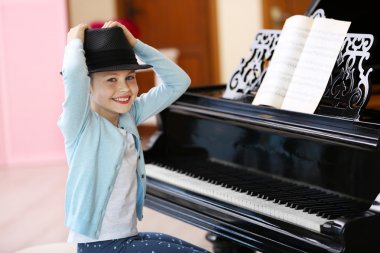 Small girl playing piano