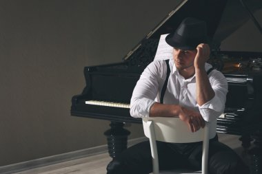 Handsome musician with piano