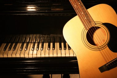 Guitar and piano, closeup