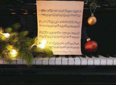 Music notes on piano keys