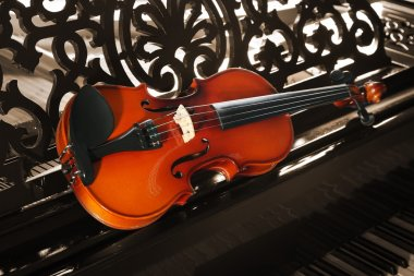 Violin on piano, closeup