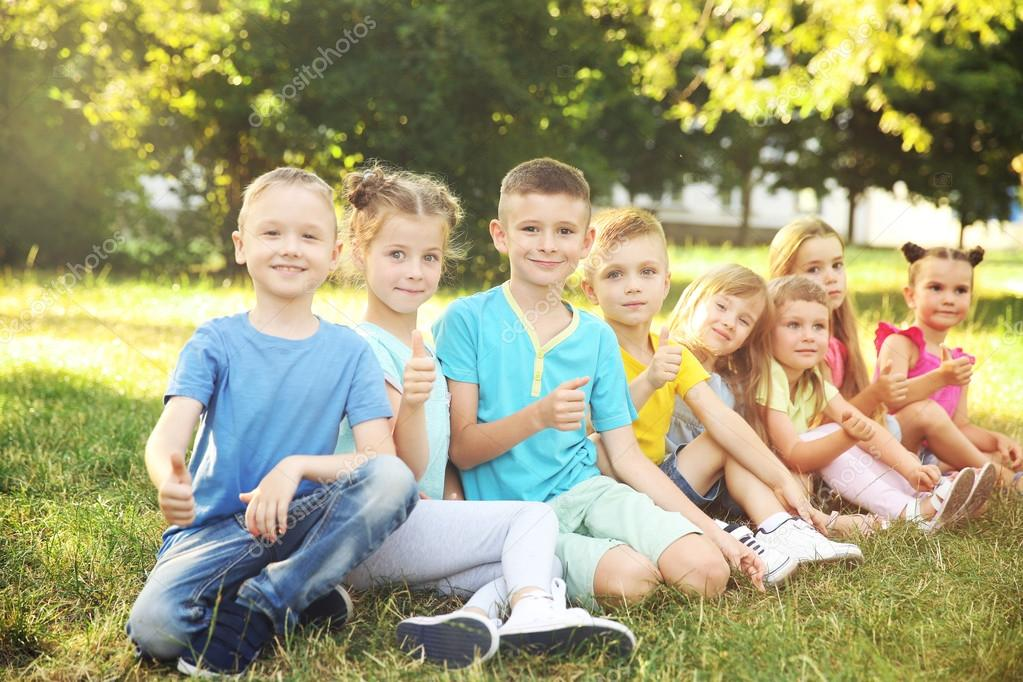 kids sitting on grass