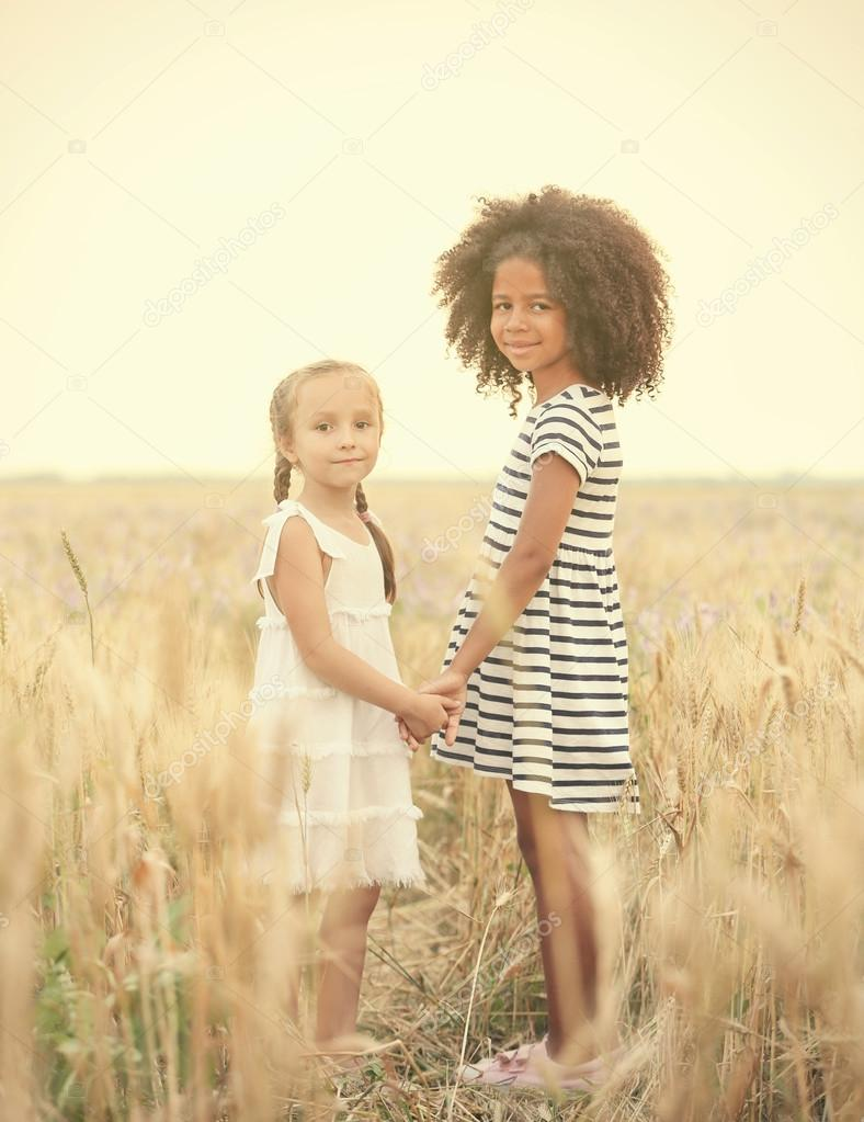 Happy children in field