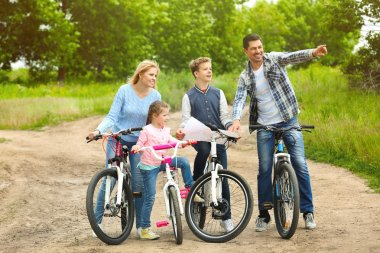Happy family on bike ride