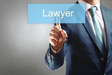Businessman hand touching LAWYER tab