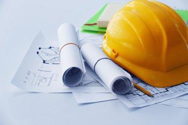 Yellow helmet  with blueprints