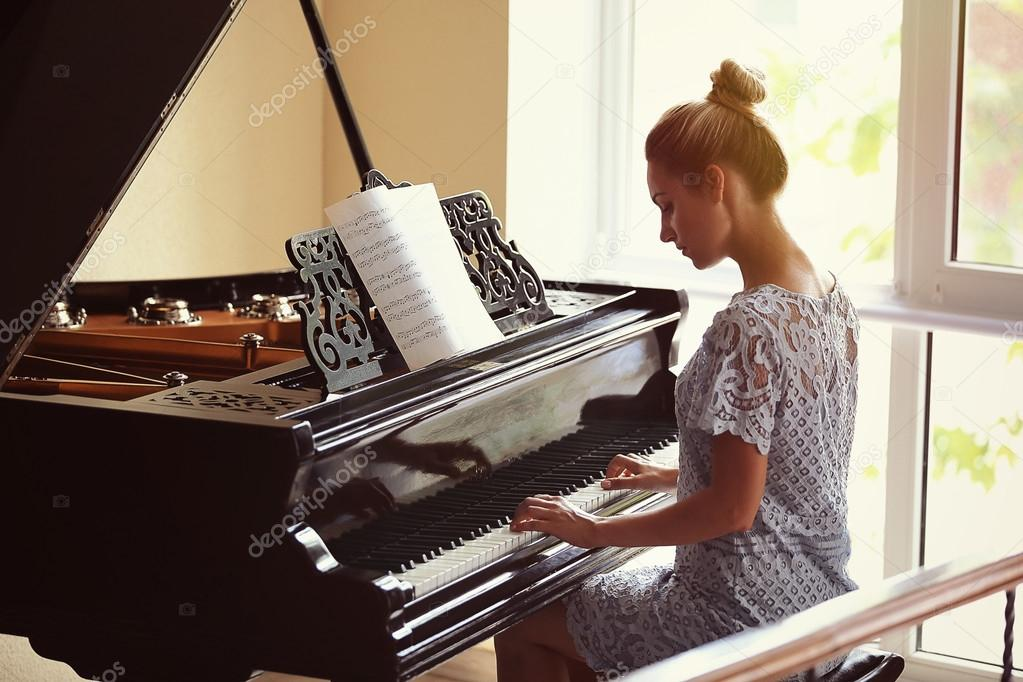 woman playing piano — Stock Photo © belchonock #121705306 - photo#8