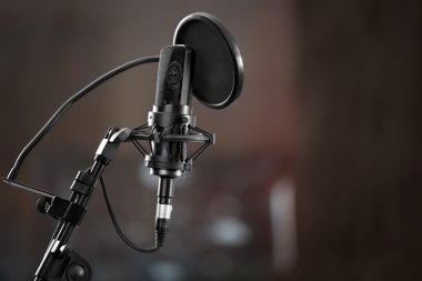 Microphone in recording studio on background stock vector