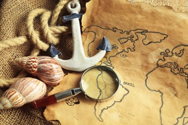 Magnifier, anchor and seashells