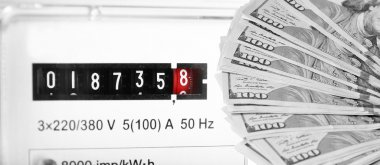 American dollars and electric meter