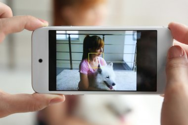 Taking photo of girl