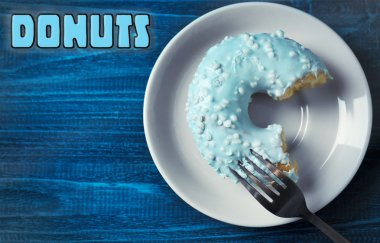 Delicious doughnut on wooden background