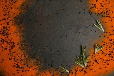 Scattered spices on dark background