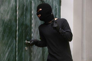 thief breaking door