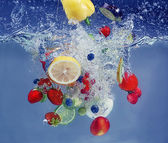 Vegetables and fruits falling into water