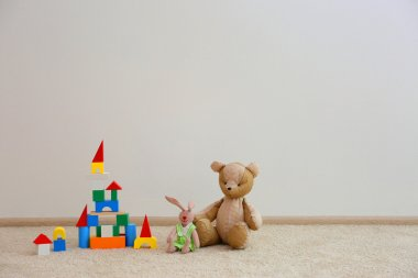 Beautiful toys on white wall background