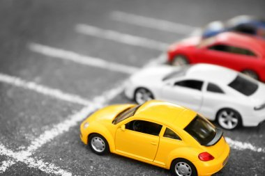 Close up of toy cars parking