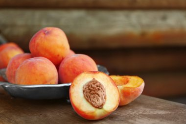 Fresh peaches on a wooden background