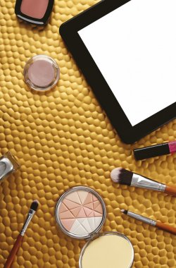 Tablet and cosmetics background