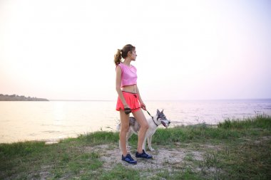 Young woman with husky