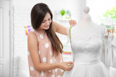 Pretty young dressmaker