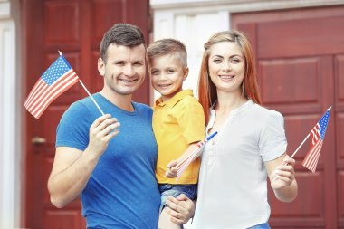 family with little American flags